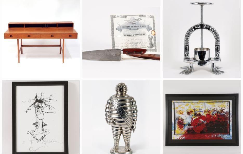 Gli oggetti di Anthony Bourdain da battere all'asta: scrittoio, coltello da cucina, pressa per anatra, due quadri e una statuetta Michelin