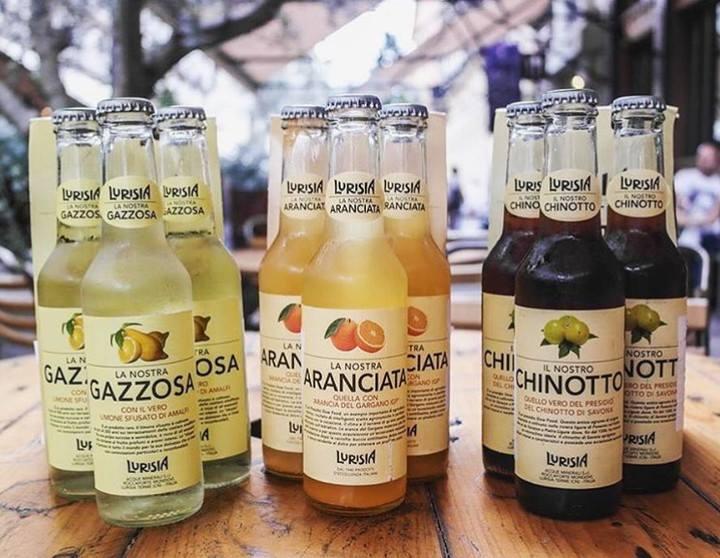 Bottiglie di chinotto, aranciata, gazzosa Lurisia