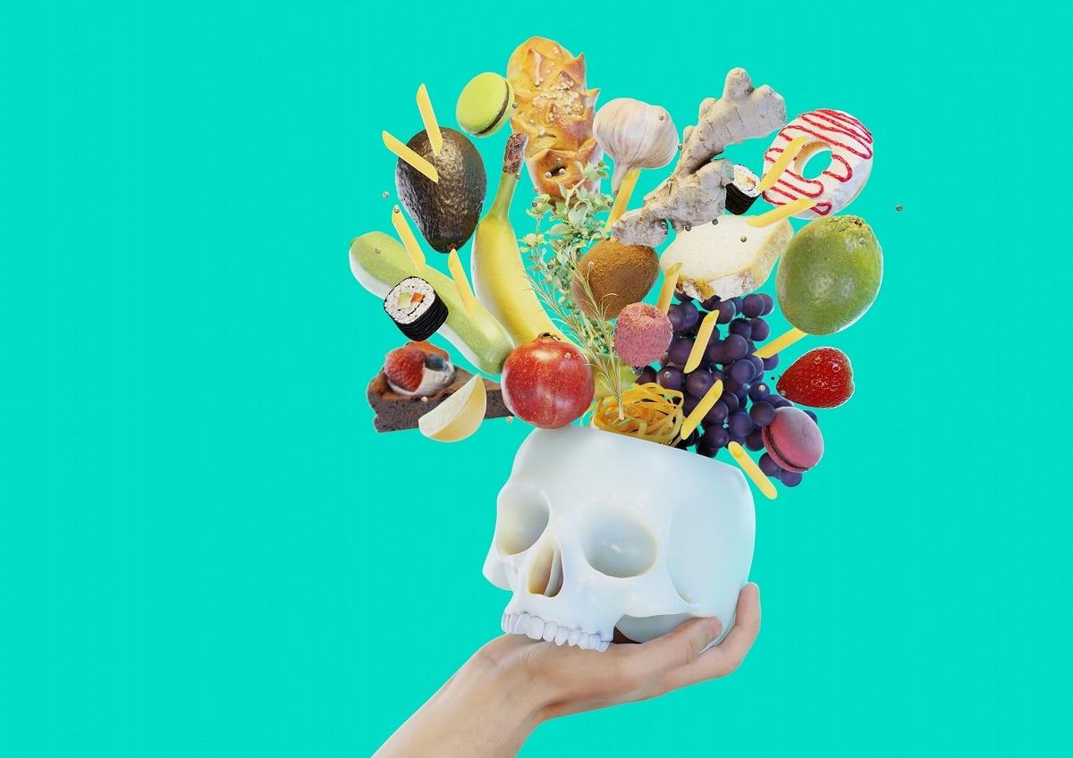 Un teschio in gesso da cui esce del cibo a Play with Food