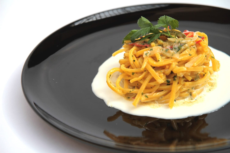 Spaghetti AOP su fonduta di parmigiano Pierluigi Di Diego Manifattura Alimentare